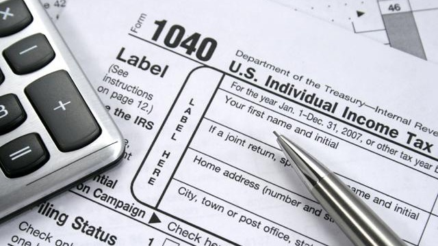 tax-forms-with-pen--calculator--taxes_159504_ver1_20161215075119-159532