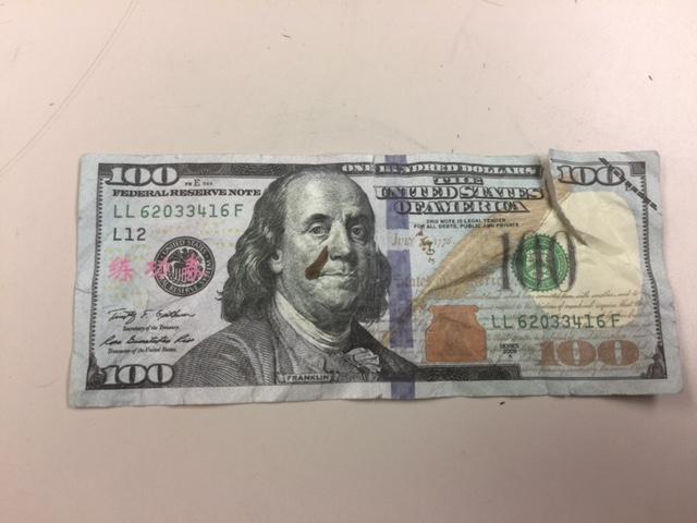 counterfeit bill_1495206193351.jpg