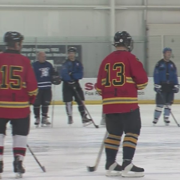 Oshkosh Police Officers and Firefighters show off their hockey skills