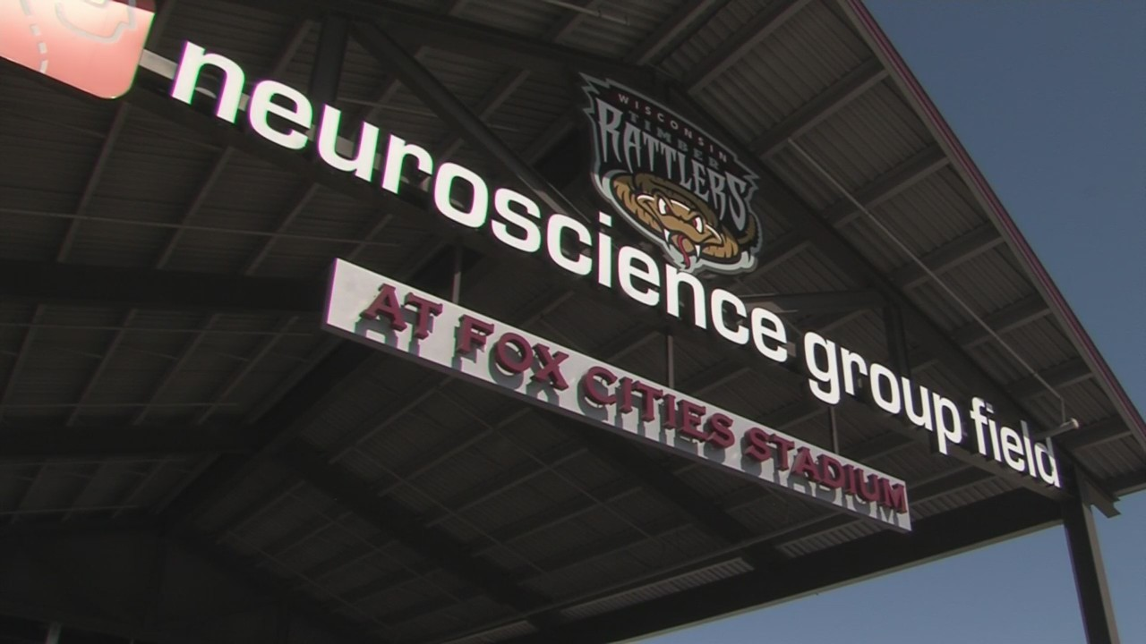 Fans cheer on the Timber Rattlers for their home opener despite the cooler temperatures.