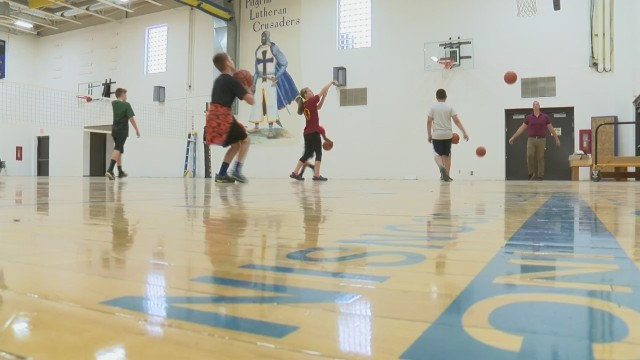 Brown County Arena flooring begins second life in local school gym