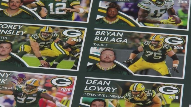 Ashwaubenon Public Safety handing out Packers trading cards