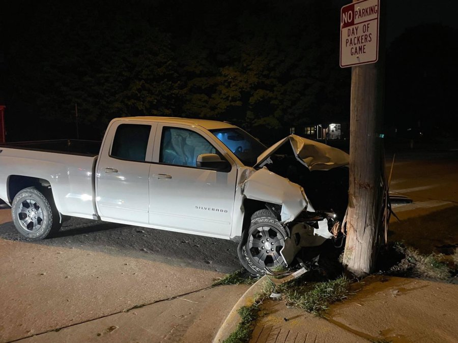 Vehicle runs into power pole in Green Bay, driver believed to have fled the scene