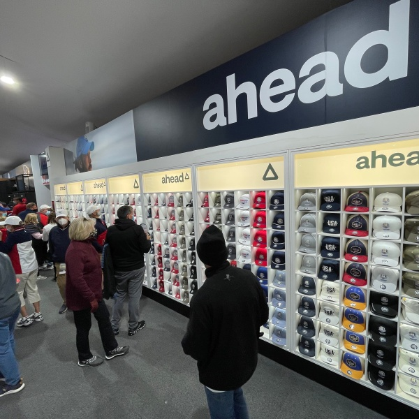 Shoppers check out the massive amount of hats and other merchandise inside the official Ryder Cup Shops at Whistling Straits on Sept. 22, 2021. (WFRV)